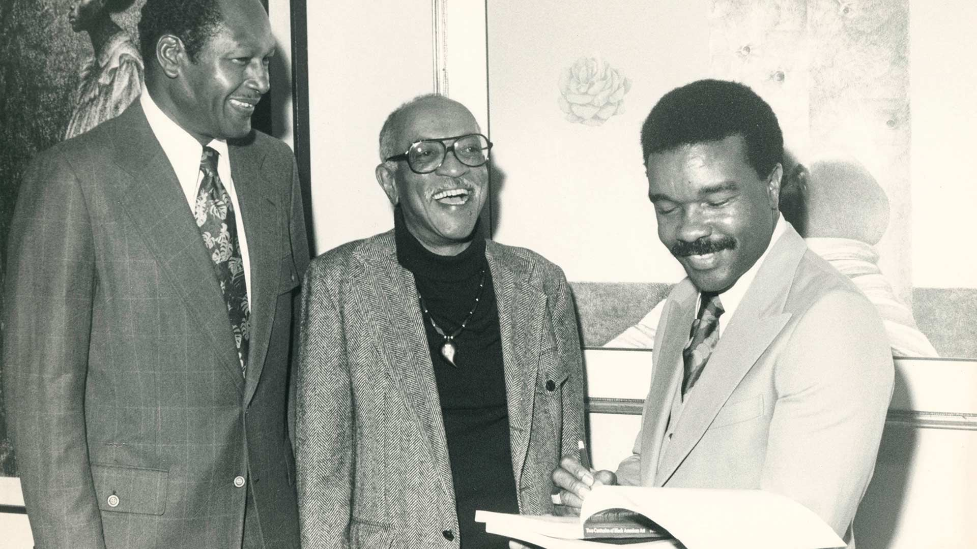 """Los Angeles Mayor Tom Bradley (left), artist Charles White and curator, scholar and artist David C. Driskell talk at the """"Two Centuries of Black American Art"""" exhibition in Los Angeles in 1976. A new crowdsourcing project run by the College of Information Studies and the David C. Driskell Center at UMD will involve the public in preserving Driskell's work. (Photo courtesy of the David C. Driskell Papers at the David C. Driskell Center)"""