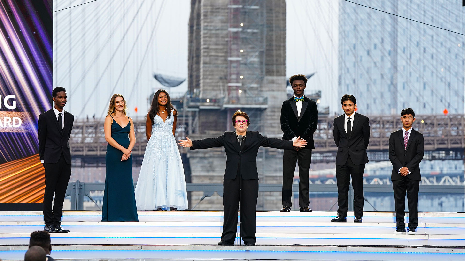 Holly Wilson '21 (second from left) stands onstage with the five other winners of the Billie Jean King Youth Leadership Award and the award's namesake (center) at ESPN's seventh annual Sports Humanitarian Awards, held at The Rooftop at Pier 17 in New York City. Wilson was recognized for her work coaching and mentoring refugee youth in the D.C. area through L.A.C.E.S. (below). (Photos by ESPN Images)
